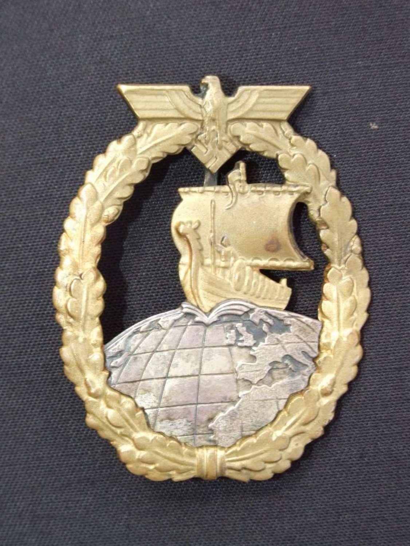Kriegsmarine Auxiliary Cruiser Badge in Tombak by Juncker