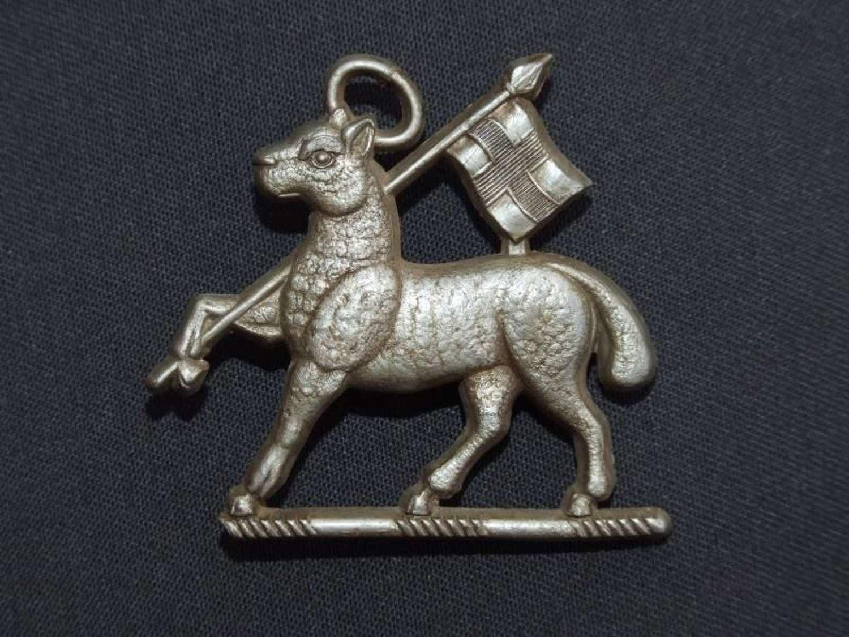 Queens Regiment Plastic Economy Cap Badge