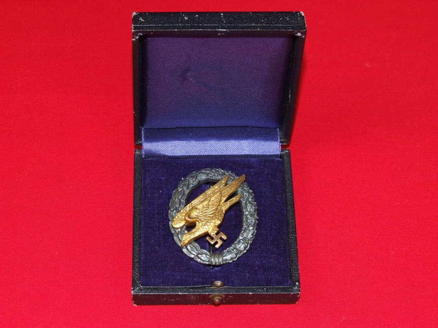 A Cased Tombac Fallschirmjäger Badge, by Wilhelm Deumer